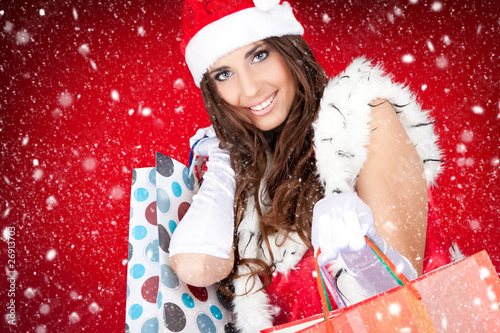 sexy santa woman  with shopping bags