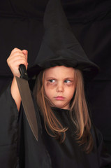 Girl disguised as a witch for Halloween