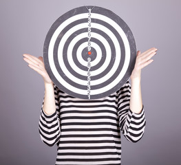 Girl with dartboard in place of head.