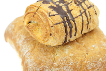 bread and roll with chocolate isolated on white