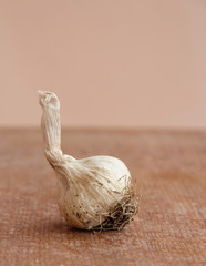 Macro view of garlic on a wooden structure