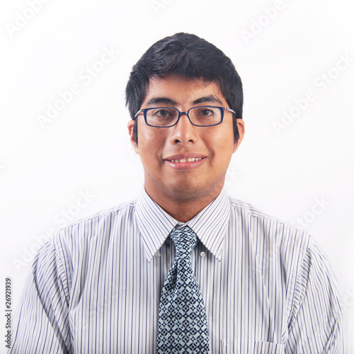 Geeky young hispanic man with glasses portrait
