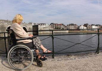 Businesswoman in a wheelchair is working