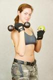 Fitness girl with green apple
