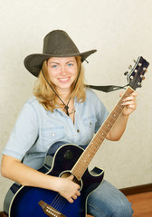 Beautiful blonde girl with guitar