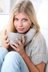 Beautiful woman drinking hot drink in winter
