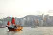 Hong Kong harbor with red sail boat