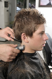 Professional hairdresser cut hair with clipper at saloon. poster