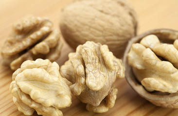 Walnuts on wooden surface