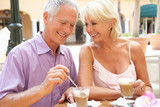 Fototapety Senior Couple Enjoying Coffee And Cake In Cafe