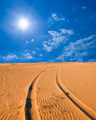 road in a sand desert by a hot day