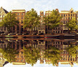Typical amsterdam houses reflected in the canal