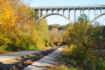 Distant train under bridge over Ohio's Cuyahoga Valley