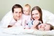 Happy family at bedroom