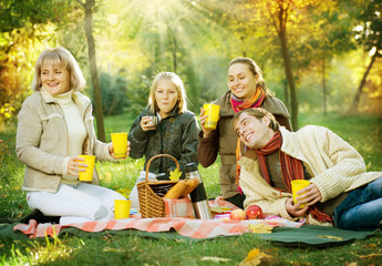 Happy Big Family in Autumn Park.Picnic.Copy-space