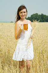 Girl  with beer at cereals field