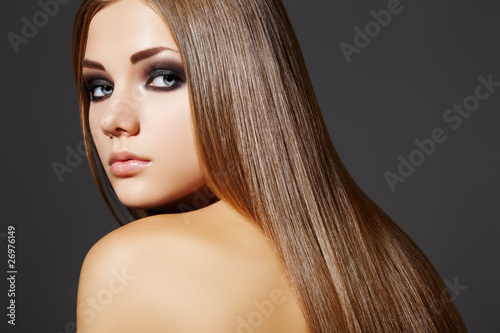 Fashion hairstyle. Model with long hair and evening make-up