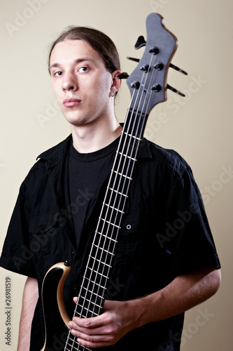 Portrait of musician with bass guitar