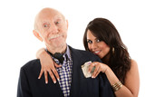 Rich elderly man with gold-digger companion or wife
