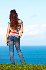 The back of an attractive woman relaxing and looking at the view