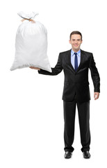 Full length portrait of a businessman holding a money bag
