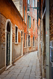 Fototapety Narrow street in Venice