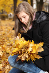 teenager in a park in autumn