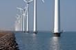 Row of windmills standing in Dutch sea