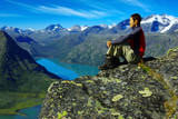 Picturesque Norway mountain landscape with tourist.