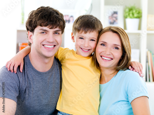 Happy faces of young family