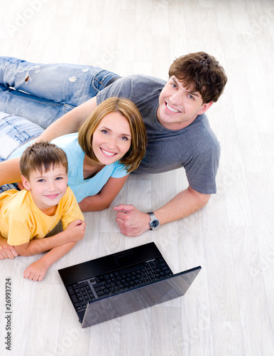 High-angle portait of family with laptop