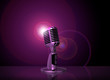 classic microphone with pink light background