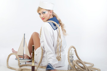 Sailor Girl with telescope and rope