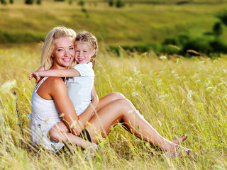 mother and little daughter on meadow