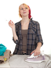 smoking woman ironing clothes, housework