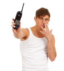 smoking young man speaking by mobil phone