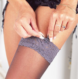 Woman Fastening Stockings. Model Released