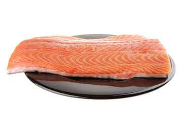 fresh uncooked red fish fillet on black