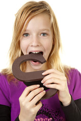 Girl with big chocolate letter over white background