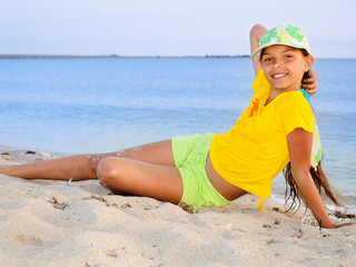 Girl in yellow at the beach