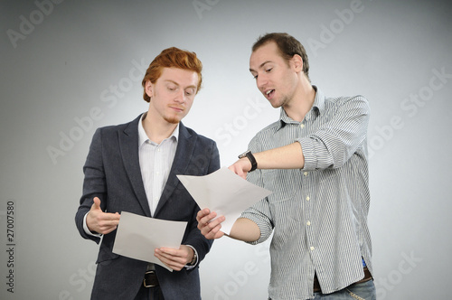 two managers explaining contracts