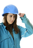 young female apprentice in blue coverall and helmet