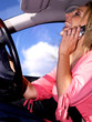 Young Woman Driving Using Mobile Telephone. Model Released