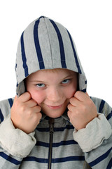 Small boy hidden in a hood smiling isolated on white