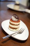 tiramisu cake on wood table background