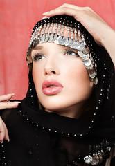 pretty woman with arabian black scarf