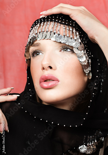 pretty woman with arabian black scarf