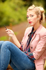 Young Woman Listening to ipod. Model Released