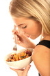 Young Woman Eating Pasta. Model Released