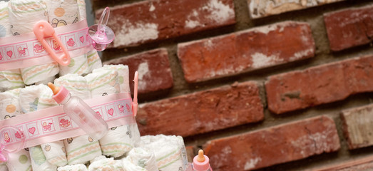 Baby Shower Diaper Cake with Bricks in Background